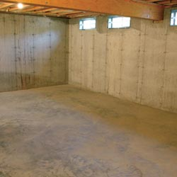 A cleaned out basement in Paterson, shown before remodeling has begun