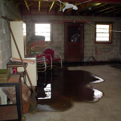 A flooded basement showing groundwater intrusion in Staten Island