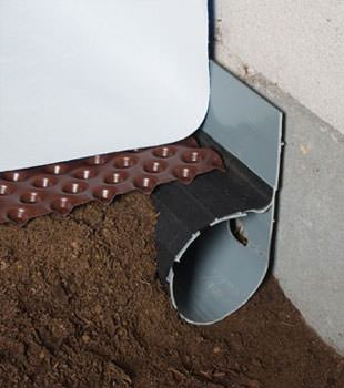 Closeup of a crawl space drainage system installed in Irvington