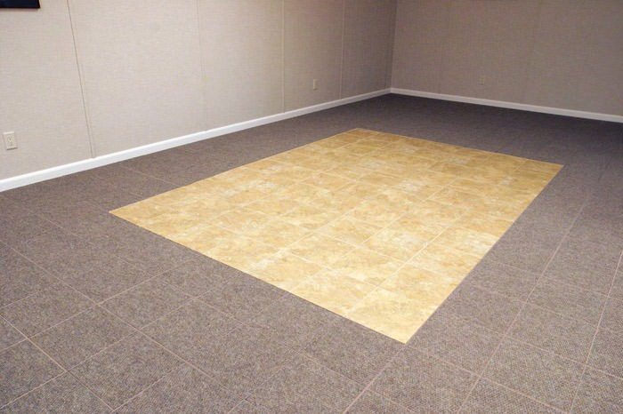 tiled and carpeted basement flooring installed in a Paterson home